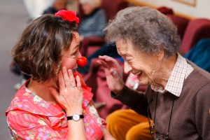 One of the Elderflowers, Blossom, entertains a service user in Edinburgh's Braeside House care home